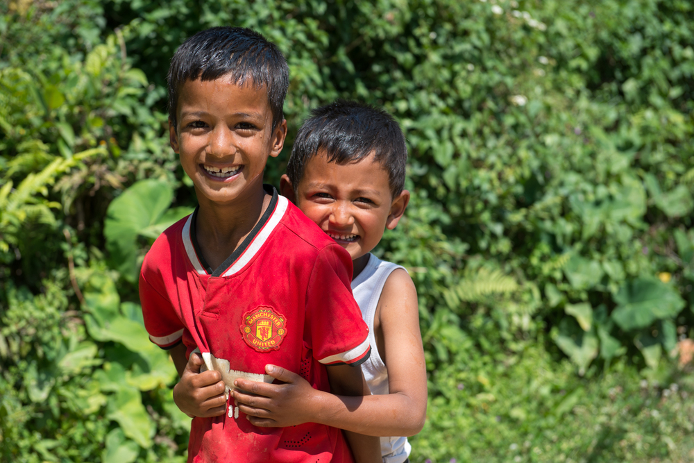 Two boys in Ramkot giggle as I take their picture.