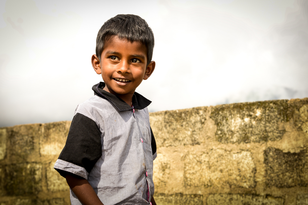 A boy enjoys playtime at our hostel -Haputale, Sri Lanka.