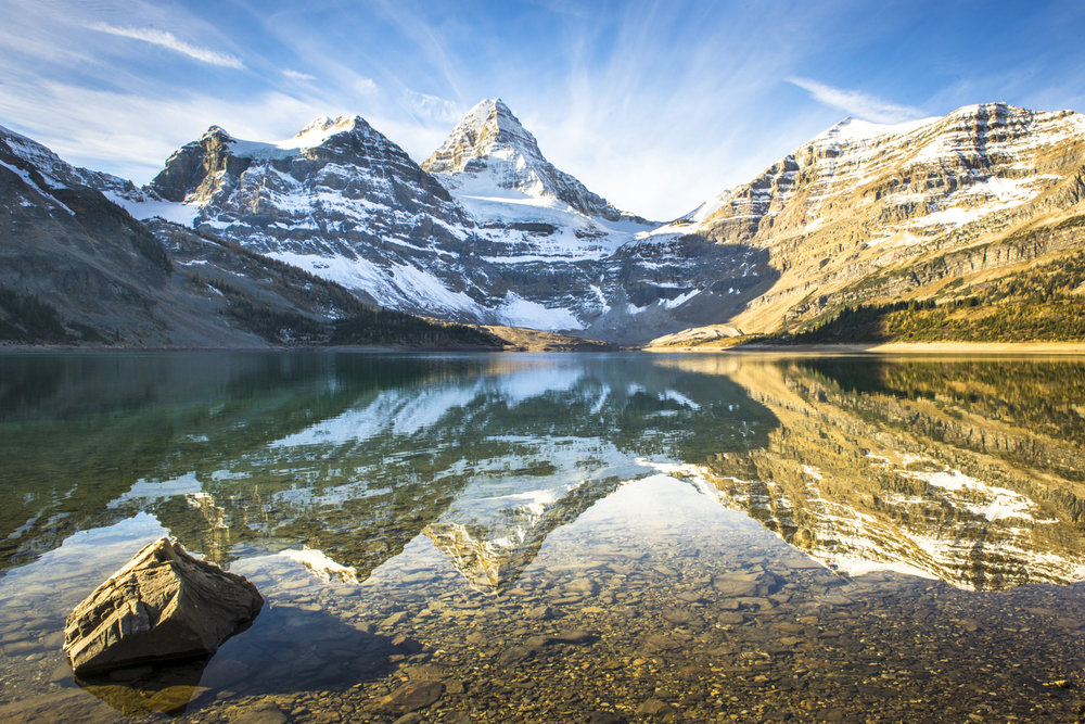 A morning reflection of Mt. Assiniboine.