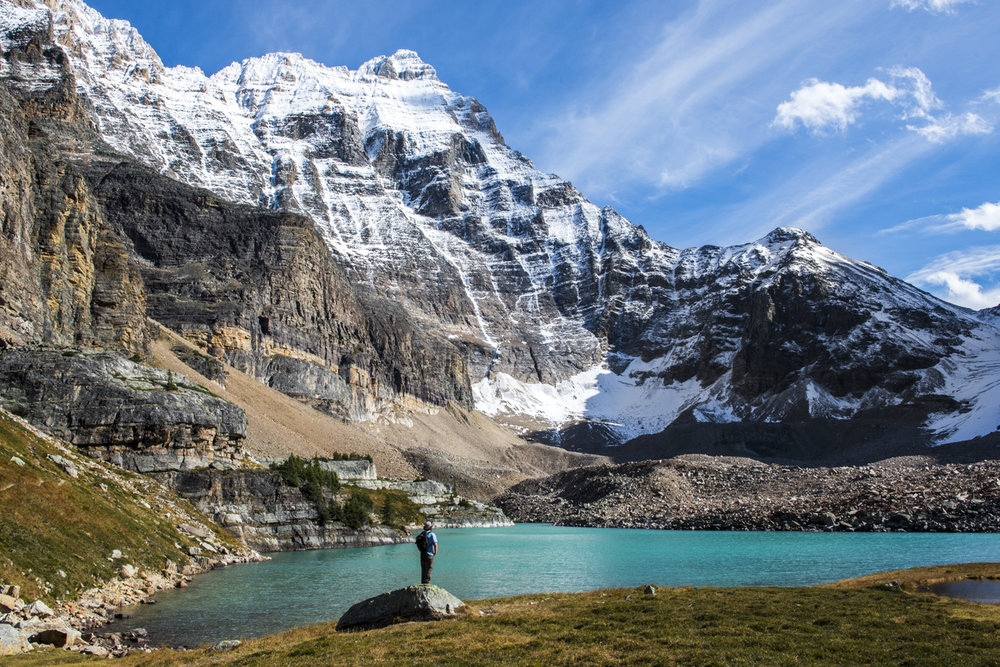 A hiker enjoys views of Lake Opabin in Yoho National Park.