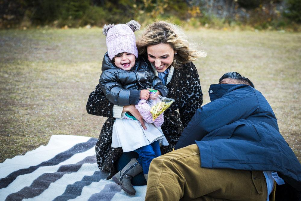 Rachel, Miraj & Charlotte's family photography session at Lake Minnewanka in Banff National Park.