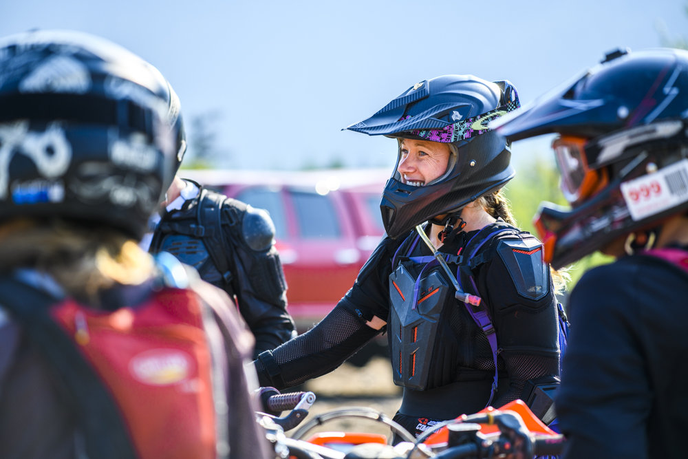 A female dirt bike athlete enjoys her company before heading to locals trails in Revelstoke, British Columbia