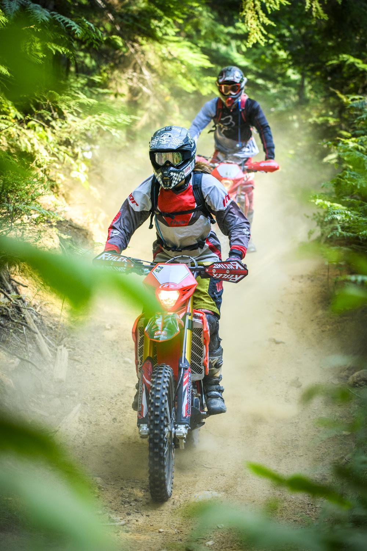 Two dirt bikers enjoy local trails in Revelstoke, British Columbia.