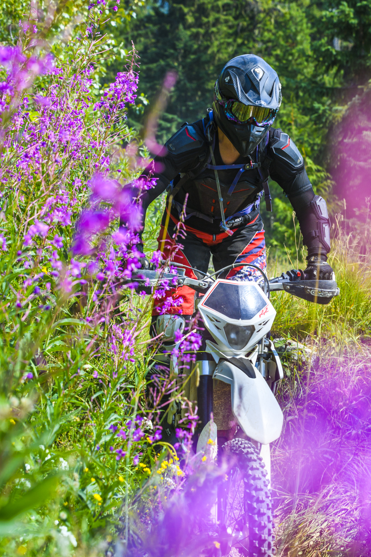 A dirt biker enjoys local revelstoke trails in British Columbia.