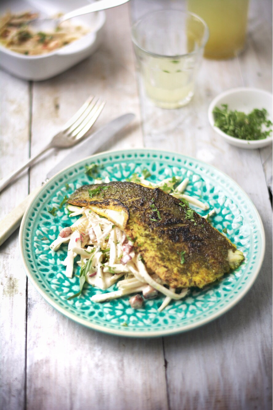 Sea bass fillet, rubbed in turmeric, herb salt and seaweed, with celeriac, chilli and carrot remoulade