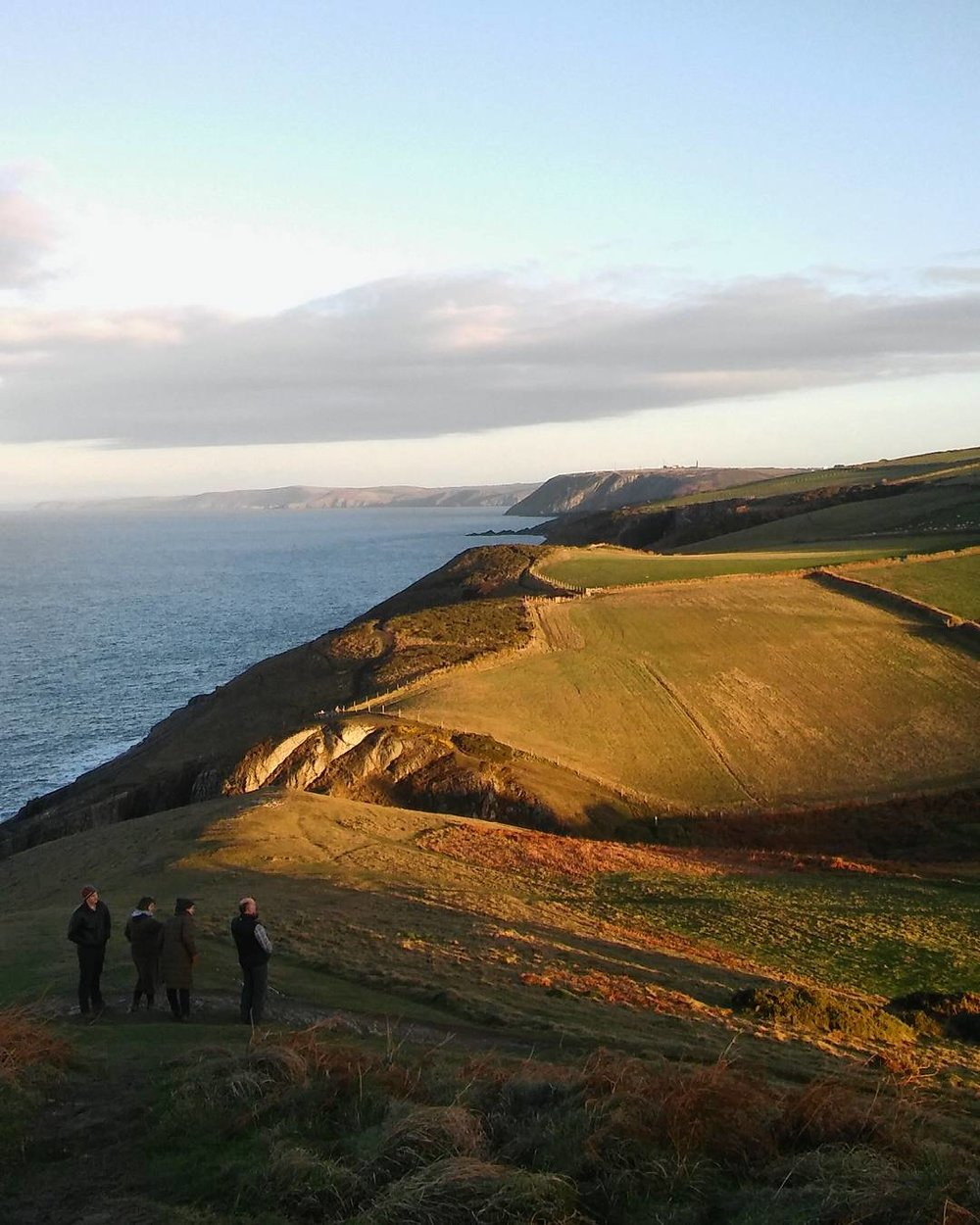 Admiring the view from the hill at Mwnt.