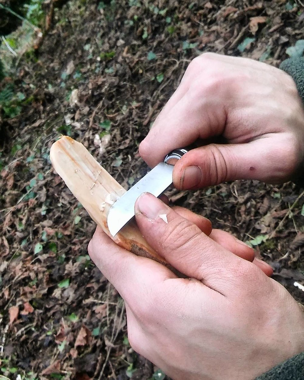 Joe carving out the spoon with his Opinel knife.