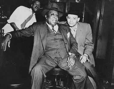 Frank Lamar (left) and John Stribbling sitting at the bar.