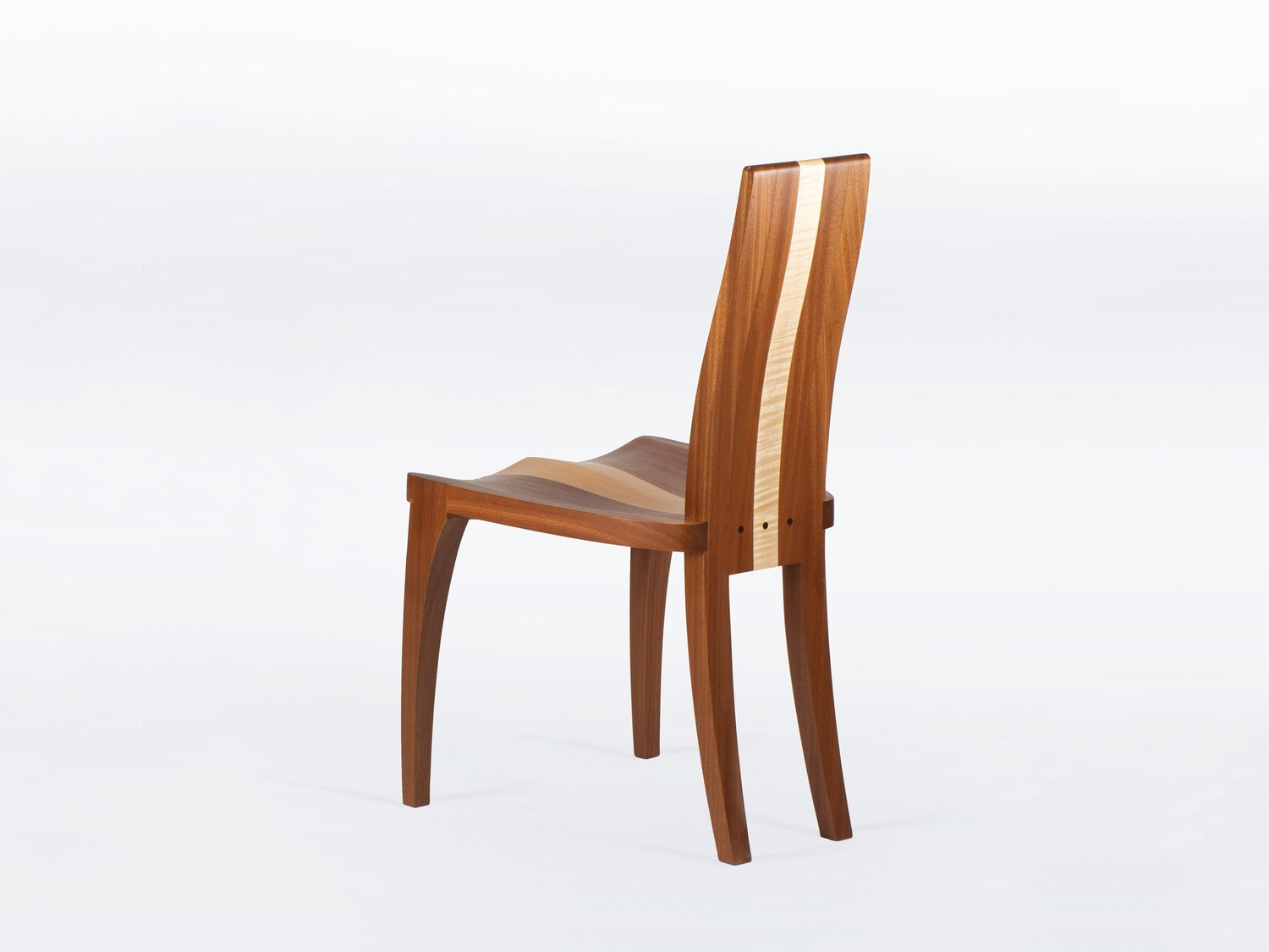 Modern dining chairs handmade in solid mahogany and maple wood available as single or set of chairs gazelle nathan hunter design