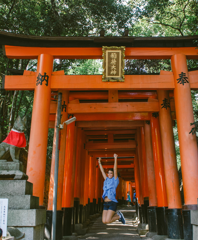 Annael jumping through the shrine Fushimi Inari.
