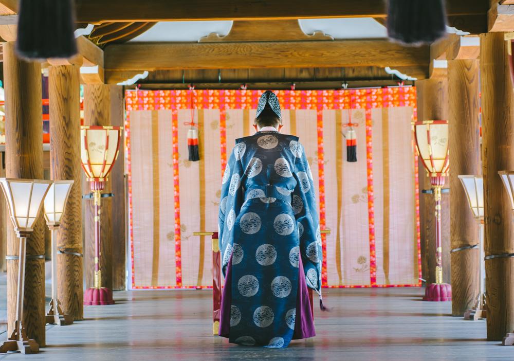Monk praying - Shintoism temple