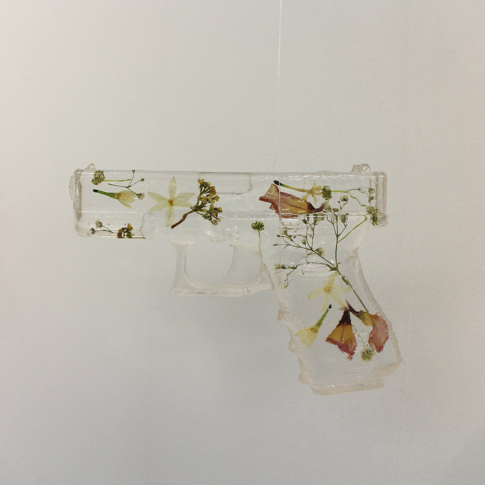 Geena Wilkinson  A girl is a gun 1  Resin & pressed flowers  17,4x 12,7 x 3 cm