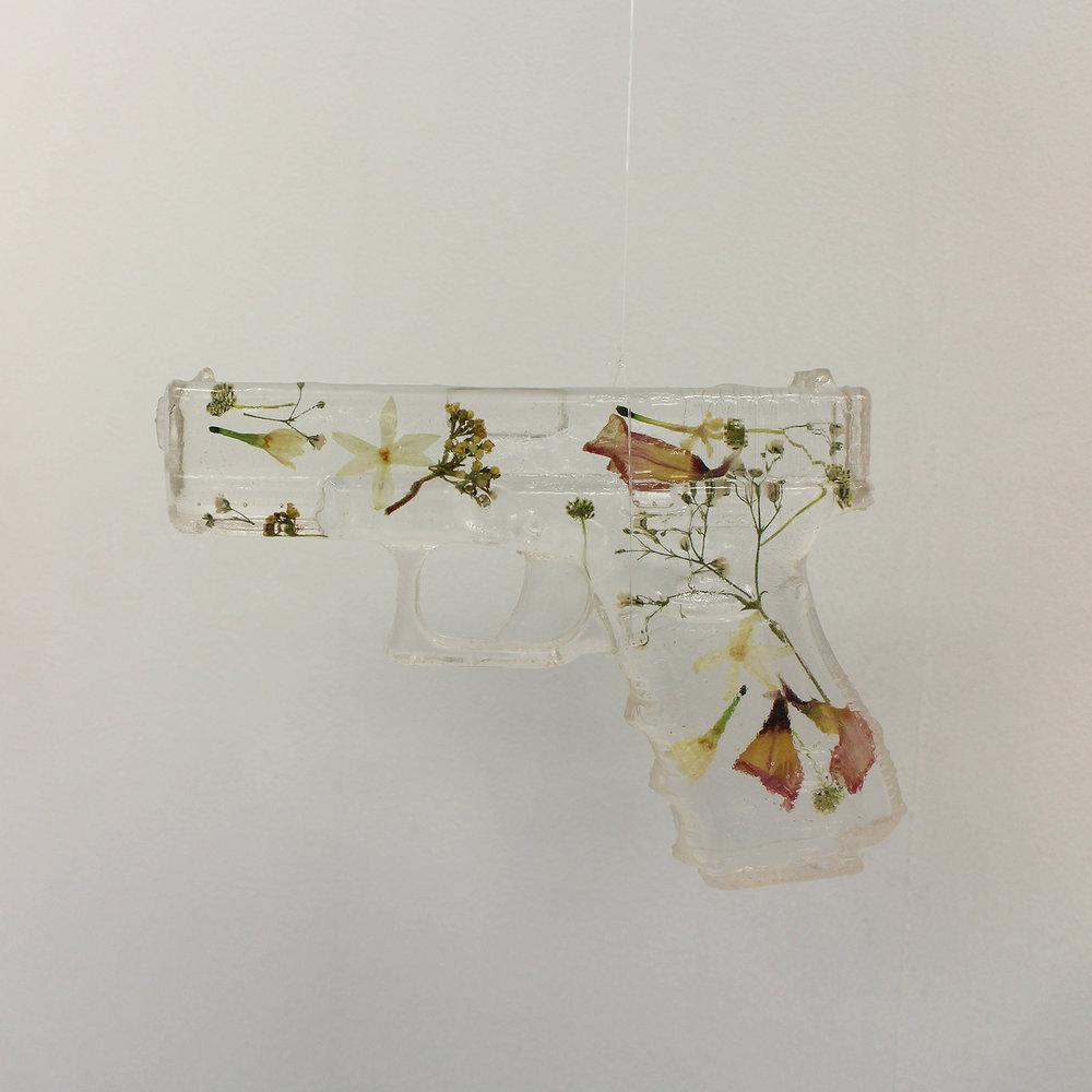 Geena Wilkinson  A girl is a gun 1  Resin & pressed flowers  17,4x 12,7 x 3 cm