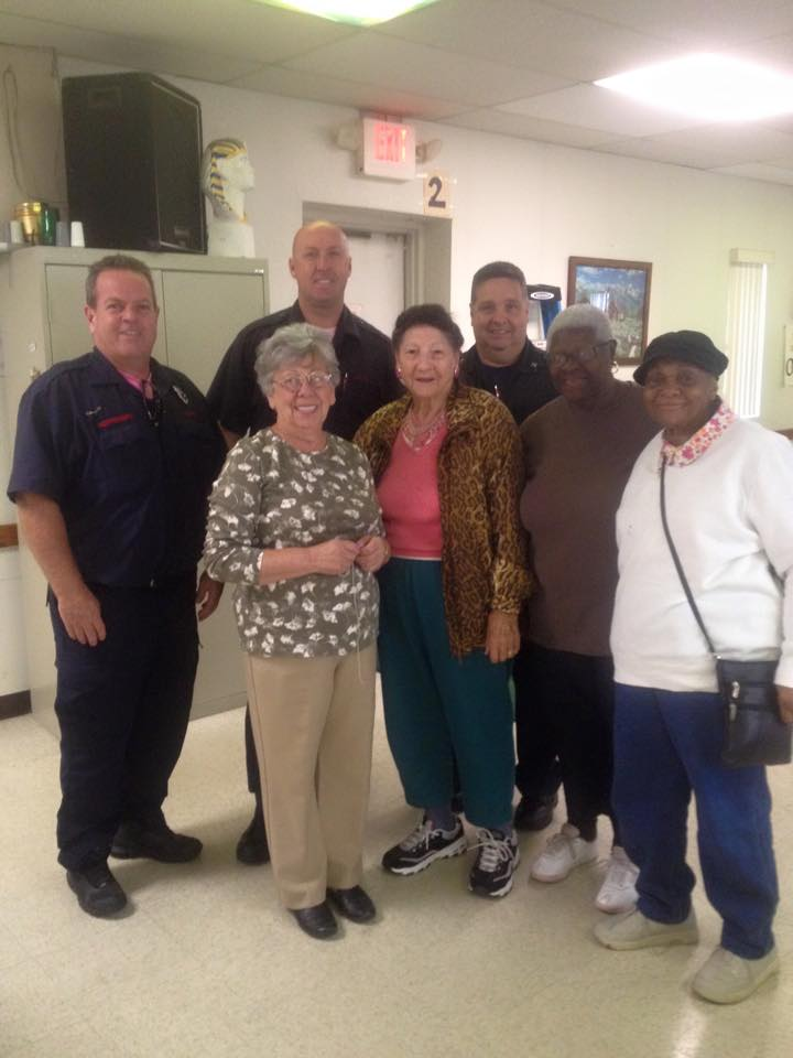Captain Tom Sessa with Firefighters Jack Tully and John Heffernan a the senior center teaching fire safety to the seniors.