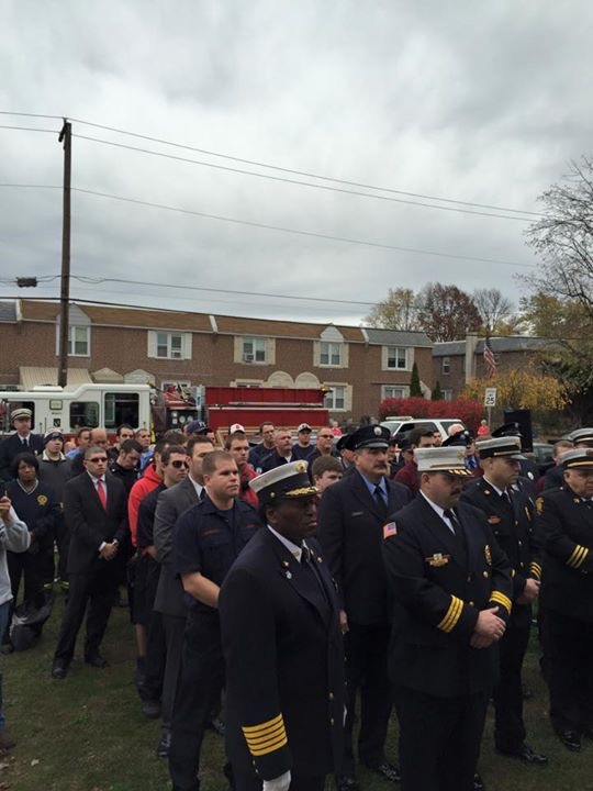A view of some of the firefighters and neighbors gathered on Chief Rankin's front lawn.