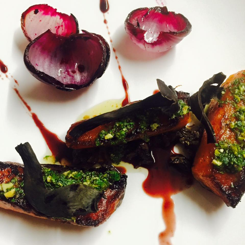 Charred winter squash with mint-pistachio pesto, cipollini onions, blood orange, radicchio, and black trumpet mushrooms.