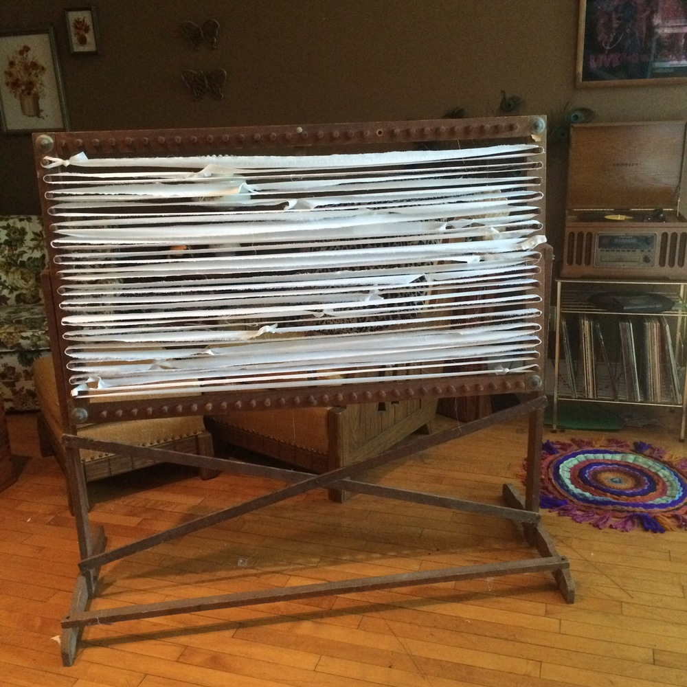 The rug loom is warped and ready. I'm staring a rag rug today and it's my first time using this loom. This loom was given to me a few months ago and I've been trying to find time/ motivation to start working on this project. Here goes!