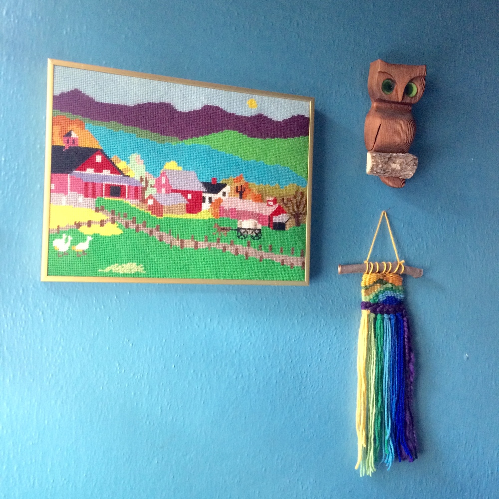 A wall in our home. Stitched art: $4. Owl: $2. Weaving: made by me.