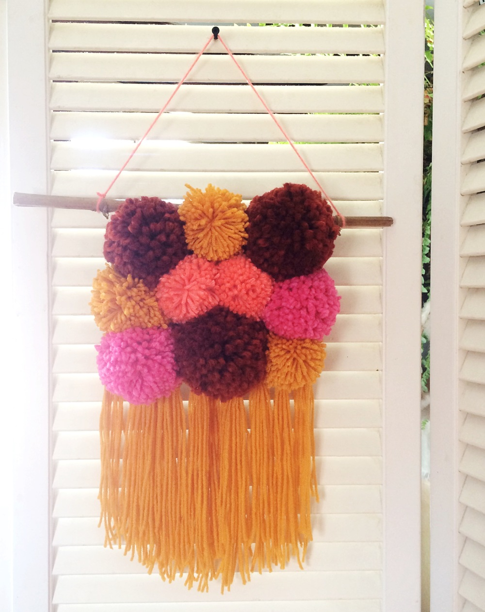 Vintage inspired pom-pom weaving.