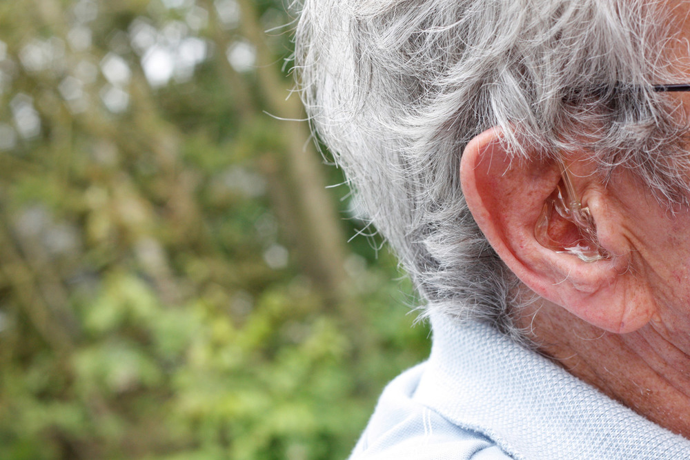 elderly-man-with-hearing-aid-ear