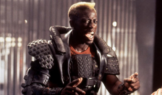 Wesley Snipes in Demolition man, with a jacket/protective outerwear made of rubber tires, reminiscent of a American Football style shoulder pads, again a nod to sportswear.
