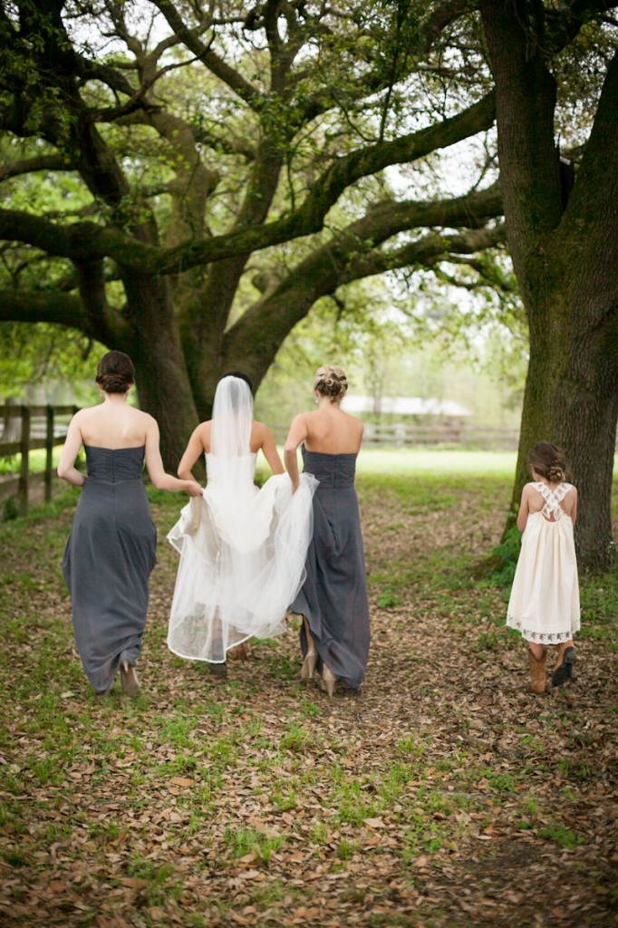Convington_Wedding_BrideWalkingbyBarn