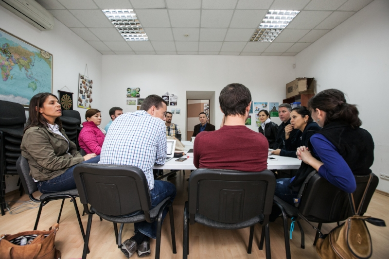 The MTW Ukraine team in L'viv have a meeting about an annual English camp that has been the catalyst for many conversions in Ukraine including that of a couple of women who now serve on their team.