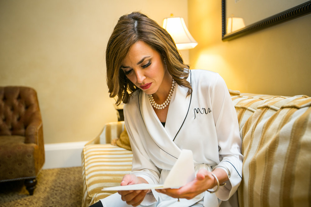 Waldorf Astoria bride reading letter