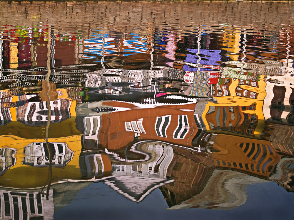 """Crooked House""  Reflection of houses in Dal Lake, Kashmir"