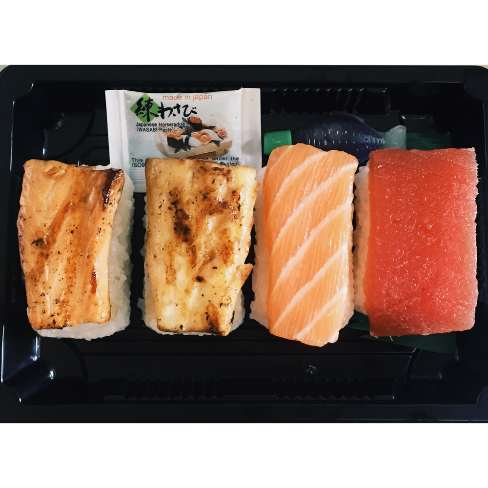 THE MIXED NIGIRI BOX - £4.50  1 x grilled teriyaki salmon nigiri, 1 x grilled teriyaki sea bass nigiri, 1 x salmon nigiri, 1 x tuna nigiri