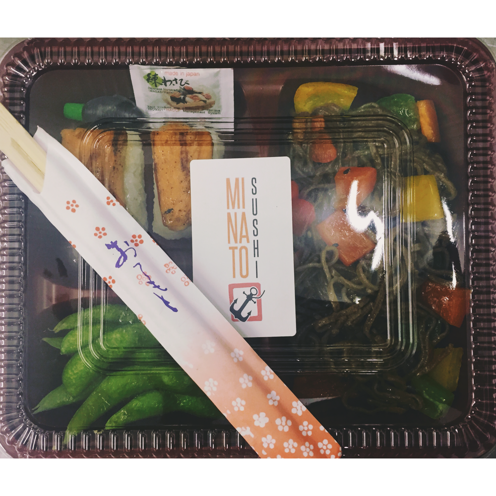 THE SOBA NOODLE BENTO BOX - £5  Includes 2 pieces of grilled teriyaki salmon nigiri, salted edamame beans and a portion of soba noodles with mixed vegetables topped with toasted sesame seeds and chilli flakes