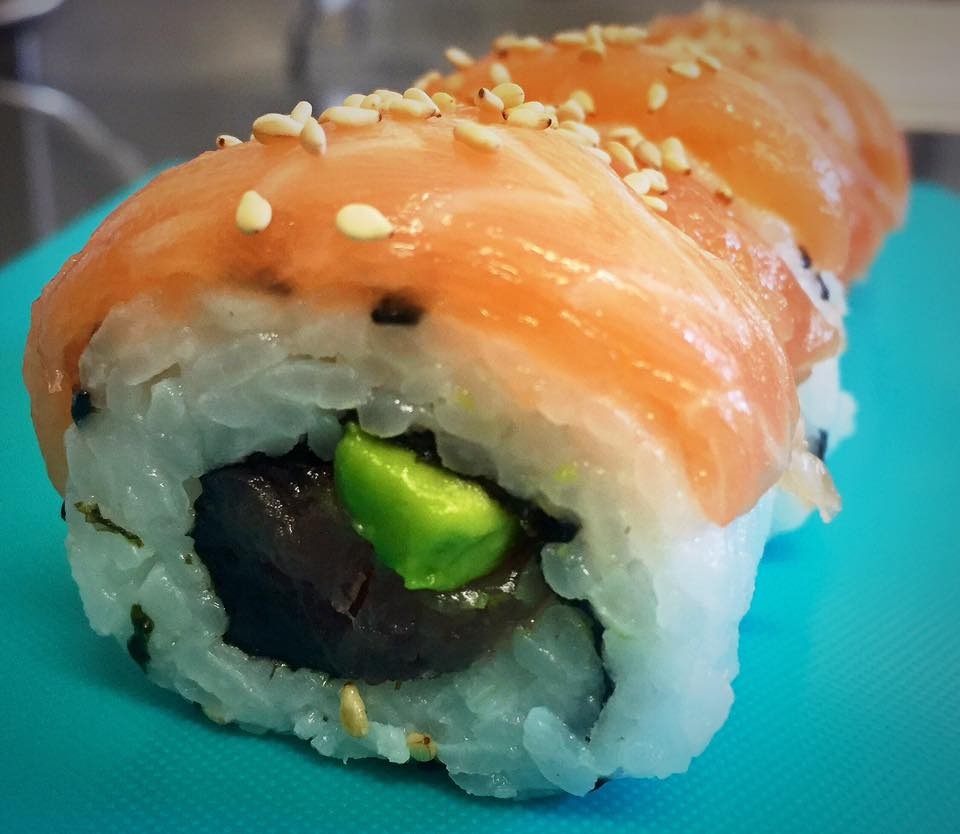Tuna & Salmon Roll - £6.50   Tuna & avocado roll topped with slices of salmon and sesame seeds.