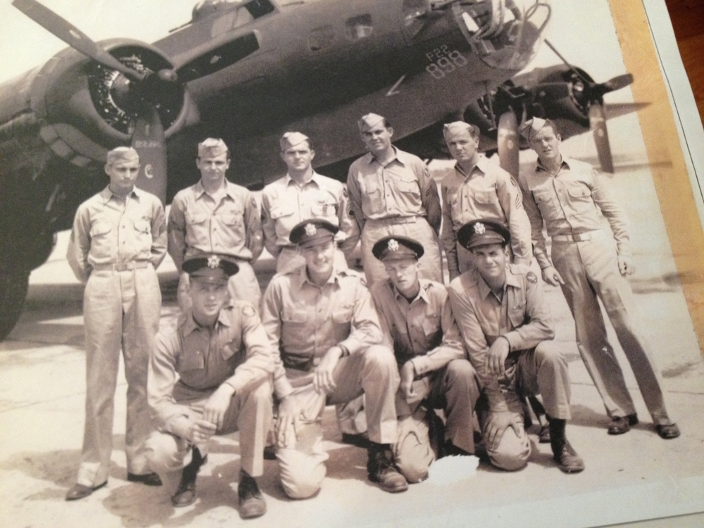 Staff Sergeant Bud Dunn, top row, second from the left, in front of his B-17 Flying Fortress, with his crewmates.  Photo courtesy of Larry Dunn.