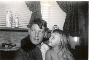 CAPTAIN CLYDE RAY JONES WITH HIS LITTLE GIRL, LESLIE (NOW LESLIE JONES), AT THEIR HOME IN ENGLAND, SHORTLY BEFORE HIS LAST MISSION AS A FIGHTER PILOT.