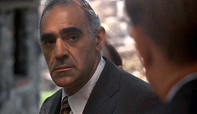 Tessio: Can you get me off the hook, Tom? For old times' sake?   Tom Hagen: (shaking his head 'no') Can't do it, Sally.