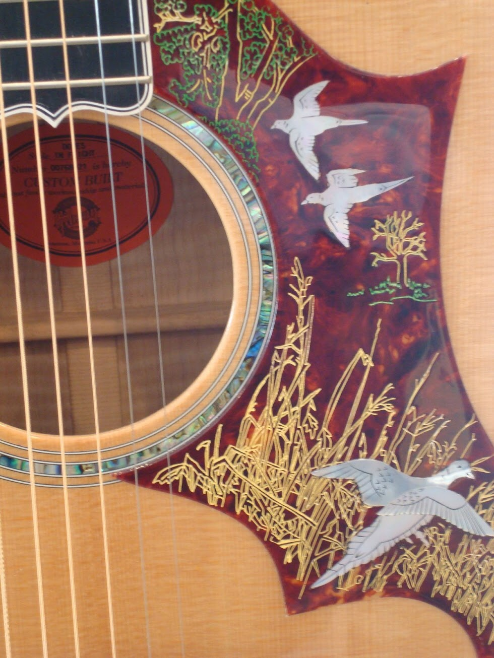 Emmylou Harris' Gibson Hummingbird guitar, available to play at the Gibson factory tour.
