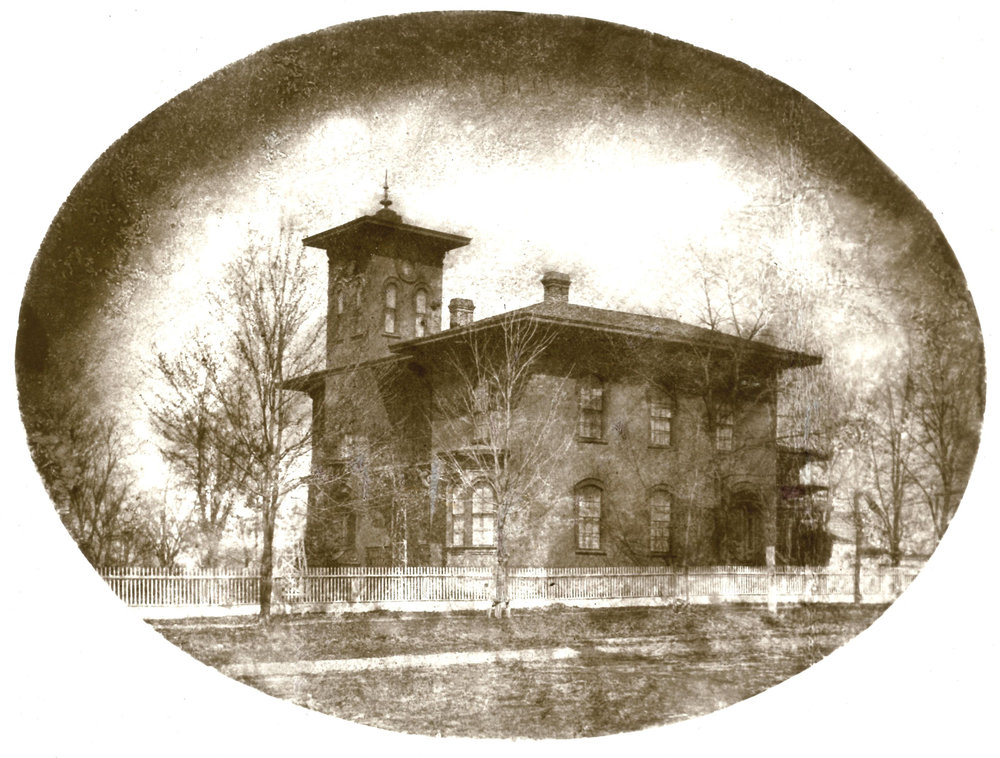 Amos Gould House, circa 1865. To the right of the house can be seen the first house built by Amos Gould, circa 1848. The old house now stands at 115 West King Street in Owosso.