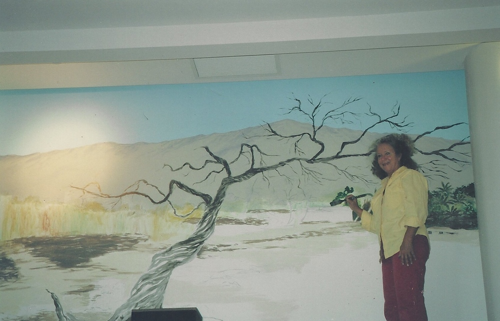 Marcia painting a mural at Hapuna Prince Hotel, HI in 1997