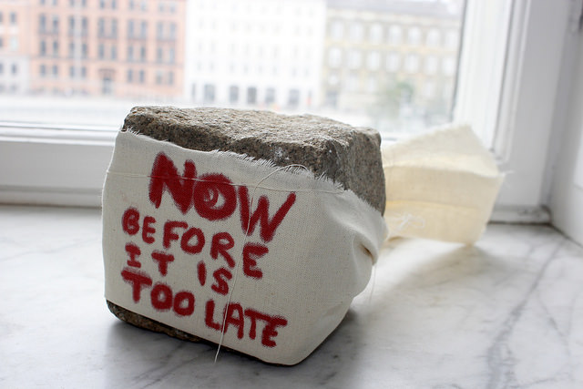 Now before it is too late,  2015, collbestone wrapped in cotton fabric with red marker text