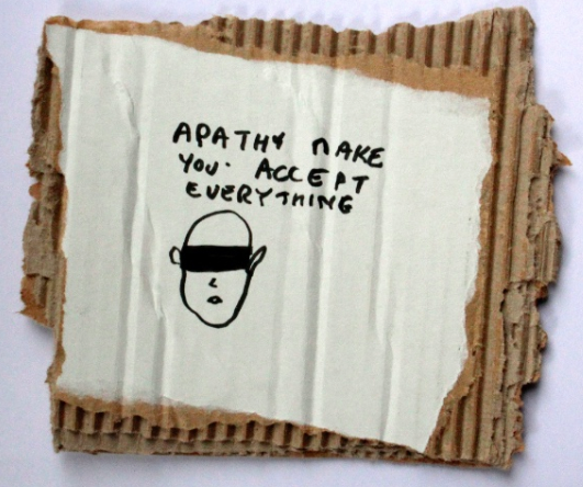Apathy makes you accept everything, black marker text and drawing on carton, 22 x 19 cm