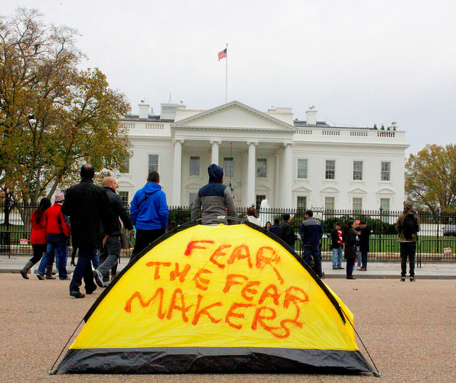 Fear the fear makers, 2015, 2,2 kilos, 2 x 1,40 m, red spray paint on a tent, exhibited in front of the White House, Washington