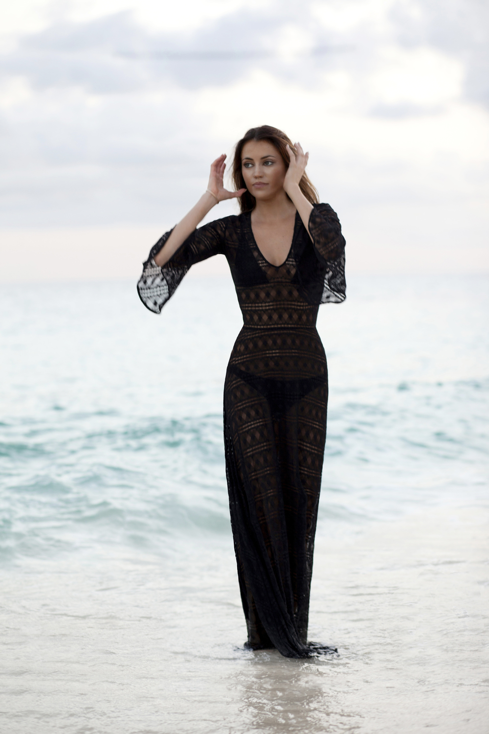 photo 6: Maureen is wearing a black dentelle pinko maxi dress on the beach in Bali at sundown.