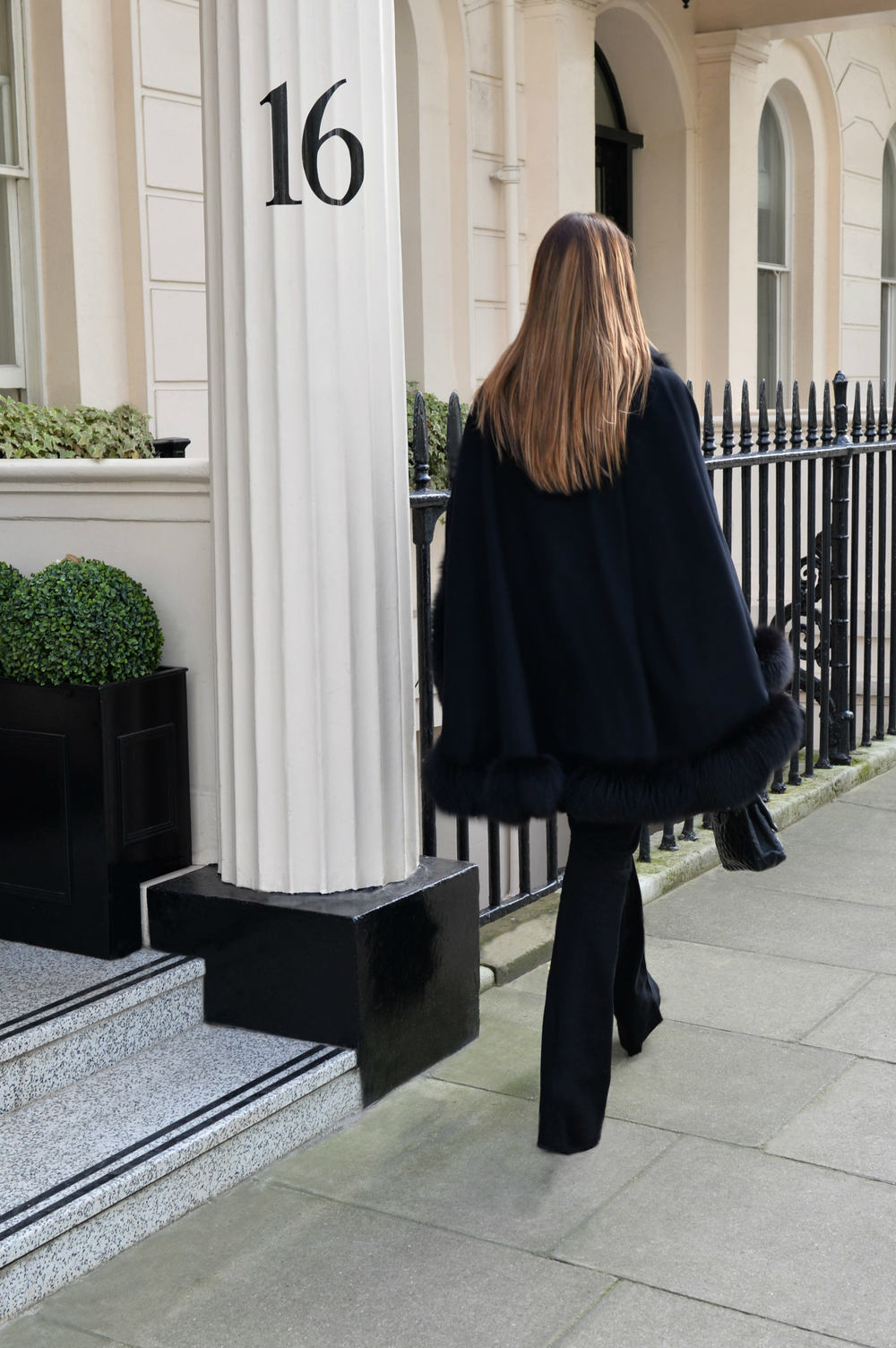 photo (1) #BlackFriday OOTD. Sharp and modern all black look. Ultra soft black cashmere cape with fur. Worn by Fashion Blogger Maureen Sophie Kragt from TheVanillawoods Blog.