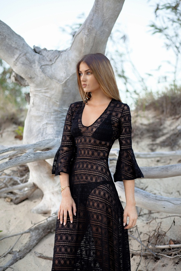 photo 2: Maureen is wearing a black dentelle pinko maxi dress on the beach in Bali at sundown.
