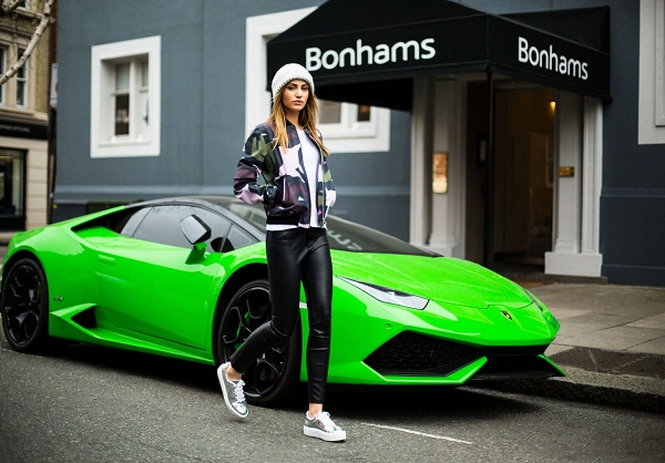 photo 1: spotted in this streets of knightsbridge, fashion blogger Maureen Sophie Kragt in high-waisted leather pants, oversized white t-shirt, tribal bomber jacket and mirror platform sneakers