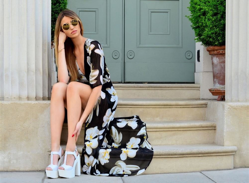 Get the look, Fashion Blogger Maureen Kragt is wearing a black floral kimono style playsuit by missy empire