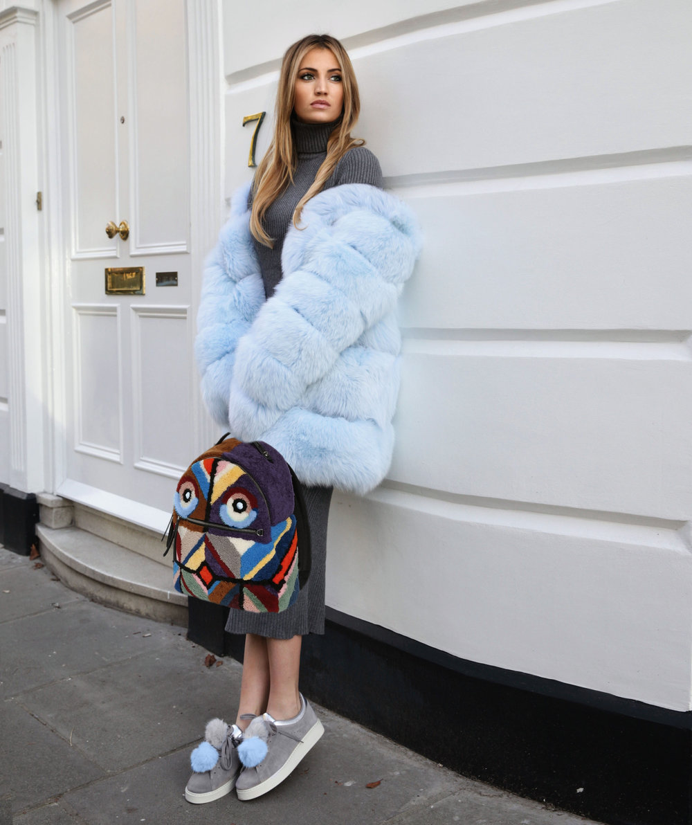 Influencer Maureen Kragt in the Boltons, shooting the latest collection of Lola Belle's furs. The Airy Blue hooded fur with ribbed zara sweater and pencil skirt.   Pair with the monster fendi backpack.   photo (1)
