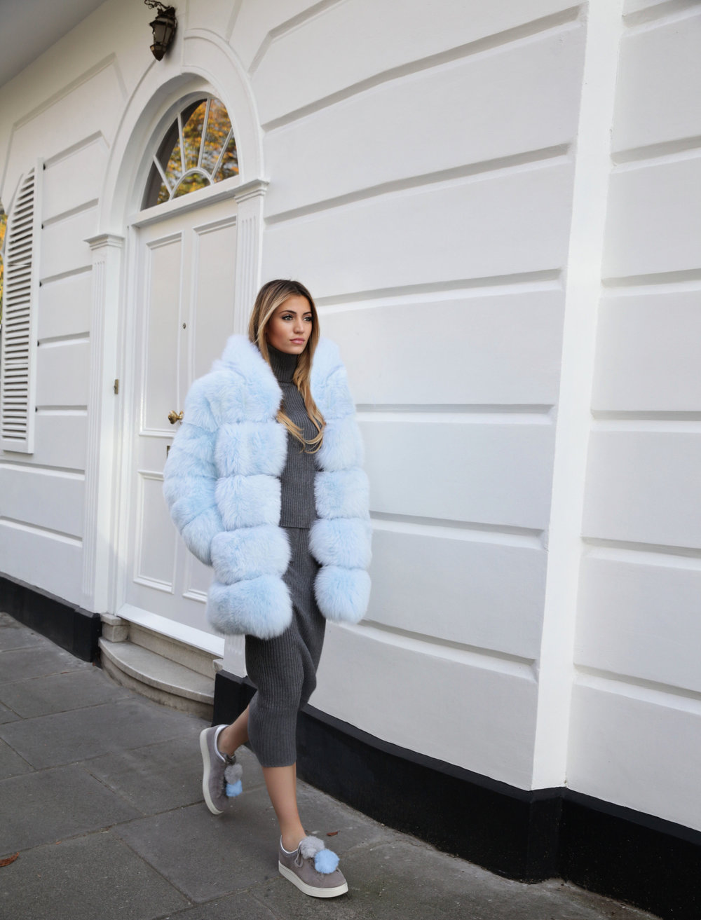 Influencer Maureen Kragt in the Boltons, shooting the latest collection of Lola Belle's furs. The Airy Blue hooded fur with ribbed zara sweater and pencil skirt.   Pair with the monster fendi backpack.   photo (2)