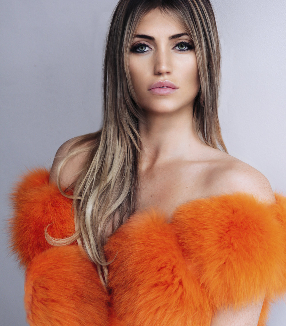 UK fashion influencer is a wearing a orange Lola Belle Fur gilet www.lolabellelondon.com. London based blogger. (4)