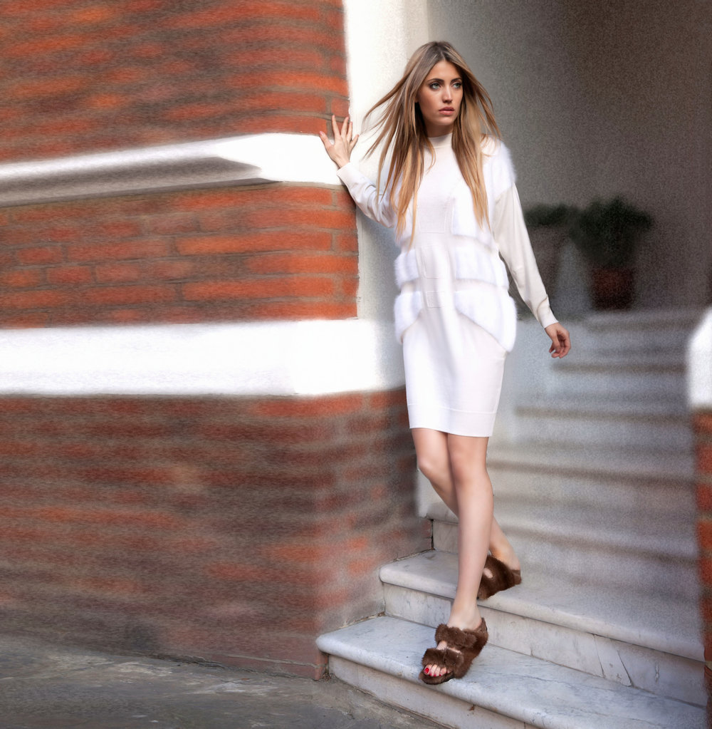 Fashion Influencer is wearing a white wool and cashmere knee length dress with brown mink fur birkenstock's (1)